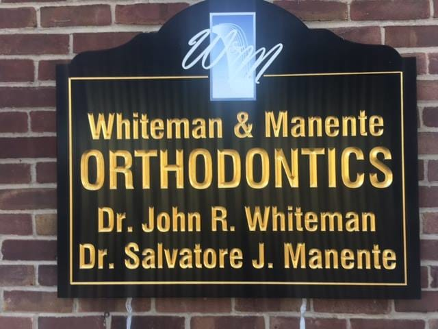 Carved Sign Whiteman and Manente Orthodontics