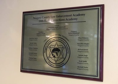 Plaque Niagara County Law Enforcement Academy Dedication Plaque Wood, Brass Dedication Plaque Engraved Signs brass plate Interior Signs Plaques Niagara Falls Air Reserve Base Niagara County, NY Government